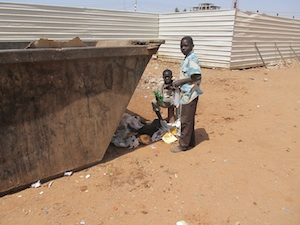 poor sad kids dumpster diving in sudan