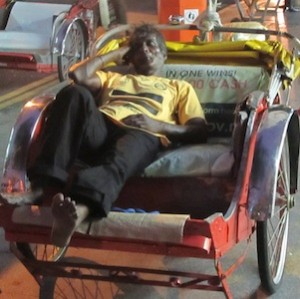 bicycle rickshaw driver sleeping